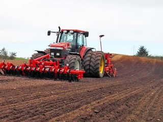 Front-Roller-in-field-seed-drill-in-back.jpg